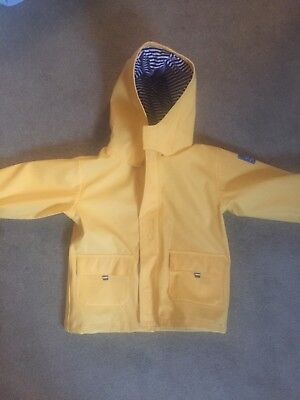 Jojo Maman Bebe rain coat unisex in yellow.