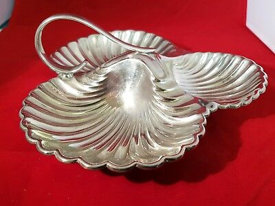 An antique silver plated shell shaped dish by mappin and webb.very ornate.