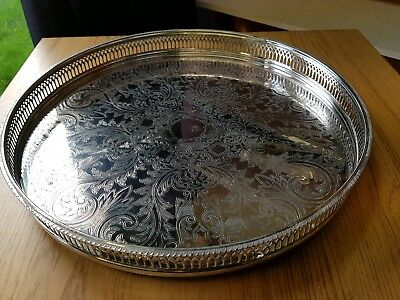 A very elegant vintage silver plated gallery tray with decorated patterns