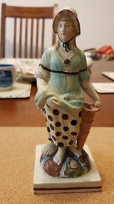 Antique Staffordshire figurine of a Fisherwoman 19th Century or earlier