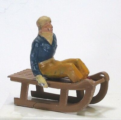 Barclay scale vintage lead toy winter figure French girl on down hill sled  BF