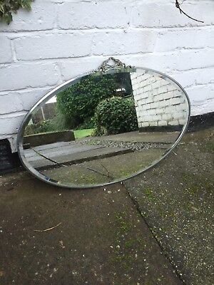 1930's DECO VINTAGE OVAL MIRROR WITH SILVER RIM AND CREST BRASS CHAIN