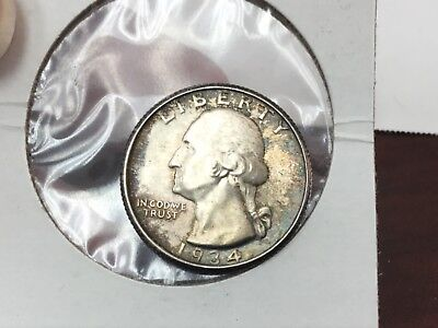 1934 Washington Quarter in Uncirculated with nice peripheral toning
