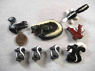 6 Assorted Skunk related Pins and Beads
