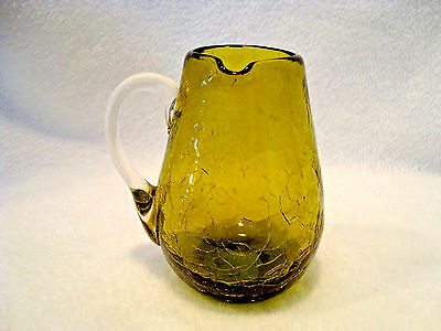 #244 Hand blown green crackle glass creamer with applied clear handle.