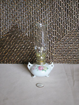 Miniature decorative oil lamp footed handles colorful floral design glass top