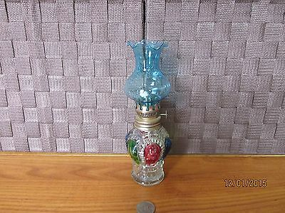 Decorative clear glass bottle oil lamp raised multi-color design blue top 7.75""