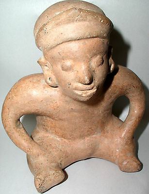 Pre-Columbian seated Red Clay Male Figure Colima, Mexico C. 250BC -250AD