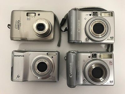 Lot of 4 Digital Compact Point & Shoot Cameras UNTESTED Canon, Nikon, Olympus