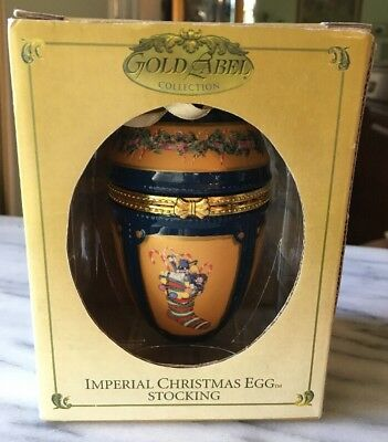 Imperial Christmas Musical Egg (Deck The Hall) Gold Label Revolving Ice Skaters