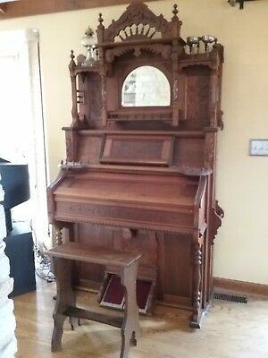 100 year old Winsor reed organ with seat . Fully restored & in working order.