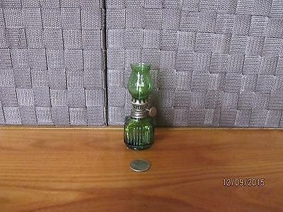 Miniature glass bottle oil lamp emerald green color raised design Hong Kong