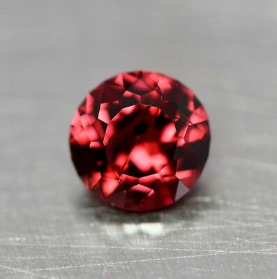 Natural pinkish red rhodolite garnet.