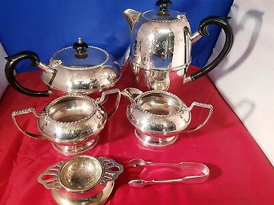 A vintage silver plated hand engraved 4 piece tea set.tea strainer & sugar tongs