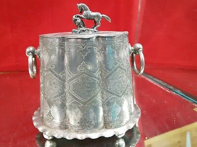 A very old antique silver plated tea caddy with horse finial.very rare.