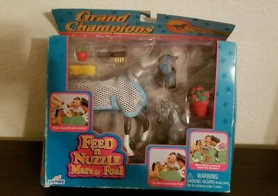 grand champions feed n nuzzle mare and foal