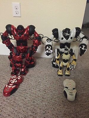 2 pair used  WowWee 8015 Robosapien, red and white colors,two extra mini robots