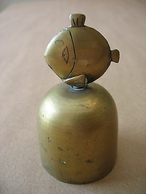 """An antique or vintage 3 1/4"""" tall solid brass bell with an engraved fish handle"""
