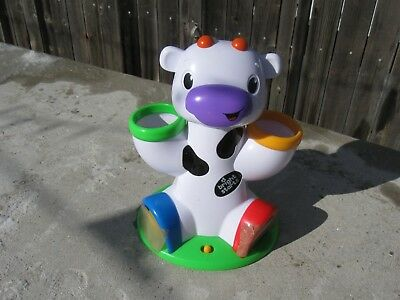 Bright Starts Having A Ball Drop and Giggle Cow. *NOTE: USED & Only 2 Balls*