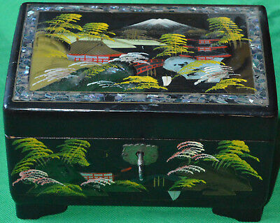 Excellent 1930s Japanese hand painted, abalone and lacquer musical jewellery box