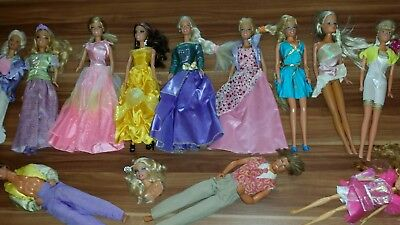 9 Barbies 2 Ken's 1 Witch