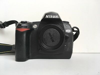 Nikon D70 DSLR Camera body only with body cap, manual and battery.
