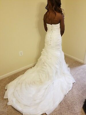 New Wedding Dress Size 12. Adjustable at the back and can be easily altered