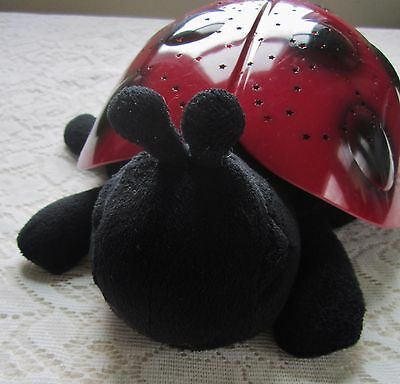 """An Adorable Red """"Cloud B"""" Twilight Ladybug~projects red, green and blue stars"""