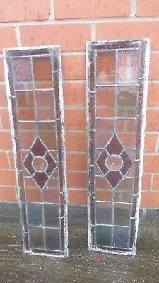 2 British leaded light stained glass windows with bulls eye in each .