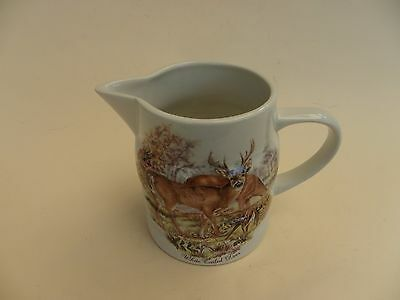 "Melba Hand Crafted Milk Jug ""White Tailed Deer""  3.75"" tall."