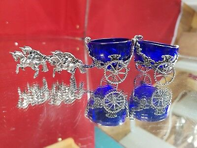 a beautiful silver plated pair of salt pots in a horse and carriage.4 horses.