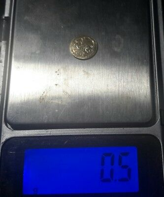 Small Gold Panda coin, 10k gold  .5 grams ex jewelry, see photos