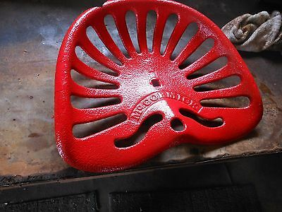 Vintage Mc Cormick cast iron seat