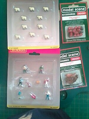 #27 ,,, HORNBY WORK CREW AND 10 SHEEP,FOUR HORSES AND A PACKET OF BARRELS  SAcks