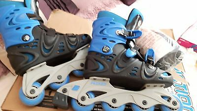 Friction inline skates with  pads.  size 4 - 5