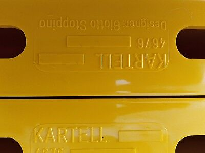 Kartell yellow magazine holder designed by Giotto Stoppino
