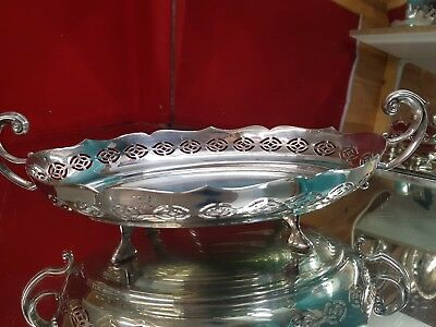 a very elegant vintage silver plated fruit bowl with pierced patterns.ornate.