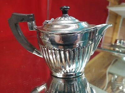 a vintage silver plated bachelor tea pot with semi fluted pattern.very ornate.
