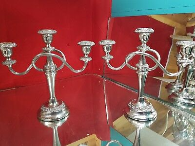 a pair of matching very elegant vintage silver plated candleabras.very ornate.