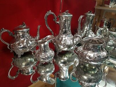 a beautiful victorian silver plated embossed 4 piece tea set.very collectable.