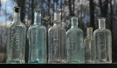 Lot of 6 Antique Embossed Dug Remedy, Balsm of Life, Extract Bottles