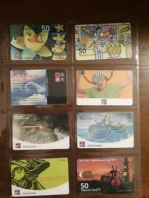 8 used phone cards from Portugal