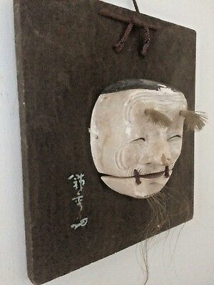 antique japanese wooden mask on a plaque Genuine antique
