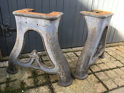 Pair of cast iron industrial legs from an early C20th lathe garden furniture etc