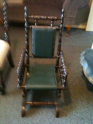childs american rocking chair,upholstered in green leather