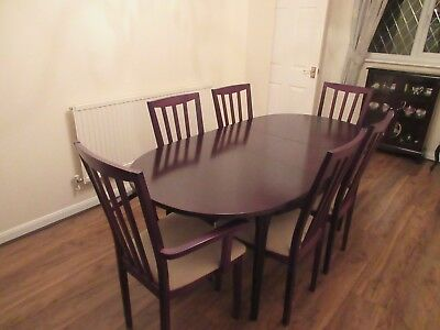 Mahogany oval dining room table (extendable) and 6 matching chairs