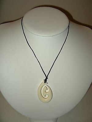Vintage Carved Faux Bone Celluloid Abstract Modernist Pendant On Black Cord