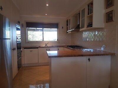 Kitchen complete with granite benchtops and built in appliances