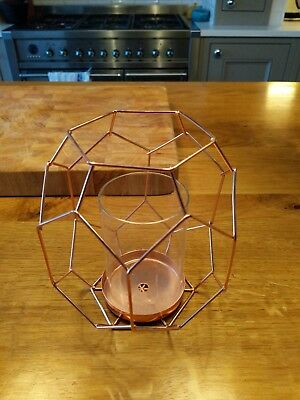 Geometric styling, copper coloured candle holder by Oliver Bonas