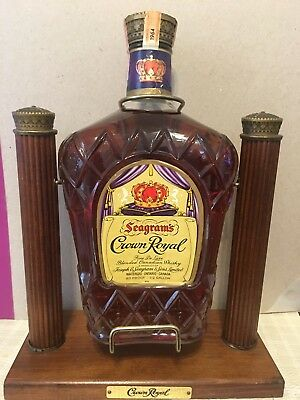 1964 vintage Seagrams Crown Royal 1/2 gal unopened in pouring stand.